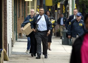 10/7/2003, FBI agent Jesse Coleman (front center, wearing tie ) along with other FBI and IRS agents arrive at 7108 Germantown Ave. in the Mt Airy section of Philadelphia October 7, 2003 to search for evidence in the Shamsud-din Ali investigation. Coleman is the subject of a Kitty Caparella story. Philadelphia Daily News / Alejandro A. Alvarez