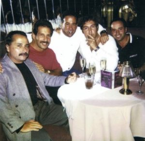 Photo 5 guys sitting around a cocktail table in the topless nightclub I operated. Bruno Malfara and Carlo Garabaldi were with a LCN family in Toronto.